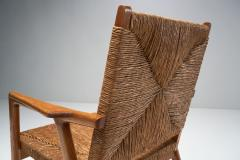 Armchair in Solid Oak and Cane Denmark ca 1960s - 1317670