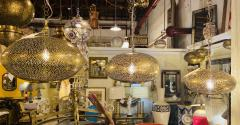 Atlas Showroom Set of Three Oval Shaped Brass Pendant Chandeliers in Graduating Sizes - 1180422