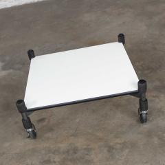 Brian Kane Post modern white laminate metal low coffee table or end table on casters - 1765229