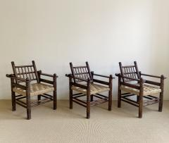 Charles Dudouyt THREE CHARLES DUDOUYT RUSH SEAT ARM CHAIRS - 2097207