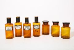 Collection of 7 Amber Glass Apothecary Jars - 2006471