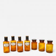 Collection of 7 Amber Glass Apothecary Jars - 2010301