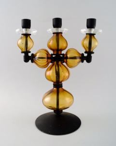 Erik H glund Large three armed candlestick of cast iron with hand blown art glass  - 1330325