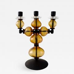 Erik H glund Large three armed candlestick of cast iron with hand blown art glass  - 1331791