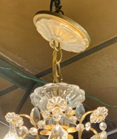 French Louis XV Style Brass and Crystal Chandelier - 1662580