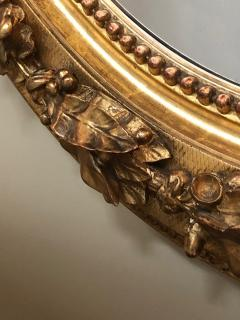 French Napoleon III Giltwood and Composite Oval Mirror with Ribbon Crest - 1896242