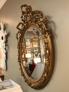 French Napoleon III Giltwood and Composite Oval Mirror with Ribbon Crest - 1896245