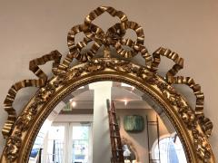 French Napoleon III Giltwood and Composite Oval Mirror with Ribbon Crest - 1896247