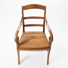 French cherry wood arm chair with rush seat and upholstered seat cushion - 1718755