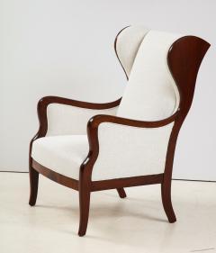 Frits Henningsen A Frits Henningsen Mahogany and Upholstered Wing Chair Circa 1940 50 - 1996689