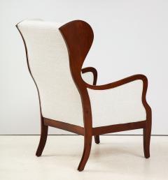 Frits Henningsen A Frits Henningsen Mahogany and Upholstered Wing Chair Circa 1940 50 - 1996694
