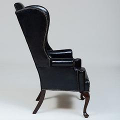 GEORGE II STYLE MAHOGANY AND BLACK LEATHER UPHOLSTERED WING CHAIR - 2011603