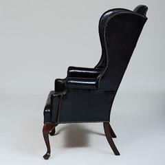 GEORGE II STYLE MAHOGANY AND BLACK LEATHER UPHOLSTERED WING CHAIR - 2011605