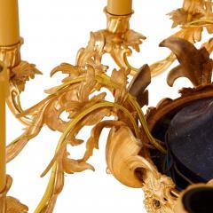 Gilt metal and lapis lazuli twelve light chandelier - 1907358