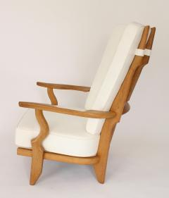 Guillerme et Chambron Pair of French Oak Grand Repos Lounge Chairs Guillerme et Chambron Votre Maison - 1308421