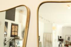 Italian Brass Framed Curved Top Vintage Shield Shaped Pair of Mirrors - 1307336