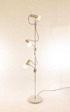 Italian chrome floor lamp with three spots and a marble base 1970s - 1092453