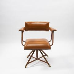 Jacques Adnet A midcentury cognac leather swivel chair - 1222283