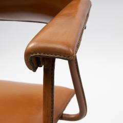 Jacques Adnet A midcentury cognac leather swivel chair - 1222285