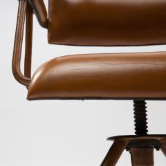 Jacques Adnet A midcentury cognac leather swivel chair - 1222288