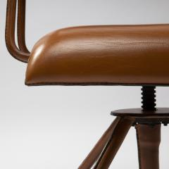 Jacques Adnet A midcentury cognac leather swivel chair - 1222289