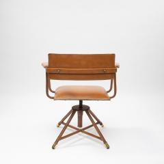 Jacques Adnet A midcentury cognac leather swivel chair - 1222291