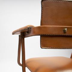 Jacques Adnet A midcentury cognac leather swivel chair - 1222292
