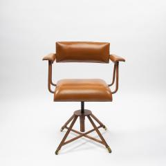 Jacques Adnet A midcentury cognac leather swivel chair - 1222293