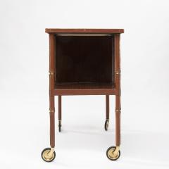 Jacques Adnet French Midcentury Mobile Bookshelf With Four Brass Wheel by Jacques Adnet - 1262027