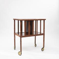 Jacques Adnet French Midcentury Mobile Bookshelf With Four Brass Wheel by Jacques Adnet - 1262043
