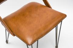 Jacques Adnet Pair Of Stitched Leather Armchairs By Jacques Adnet - 1310115