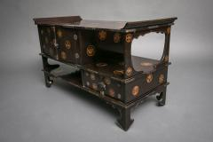 Japanese Black Lacquer Tana tiered tea cabinet with Gold Crest Design - 717217