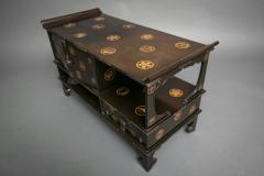 Japanese Black Lacquer Tana tiered tea cabinet with Gold Crest Design - 717218