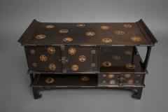 Japanese Black Lacquer Tana tiered tea cabinet with Gold Crest Design - 717220