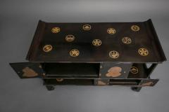 Japanese Black Lacquer Tana tiered tea cabinet with Gold Crest Design - 717240