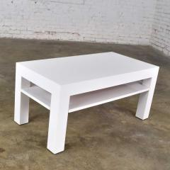 Jean Michel Frank Mid century modern two tiered white laminate parson s style coffee or end table - 1900186