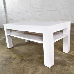 Jean Michel Frank Mid century modern two tiered white laminate parson s style coffee or end table - 1900250