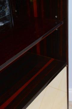 Jean Pascaud Art Deco Ebony De Macassar and Parchment Bookcase Jean Pascaud - 348536