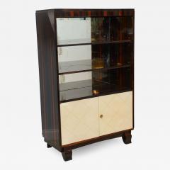 Jean Pascaud Art Deco Ebony De Macassar and Parchment Bookcase Jean Pascaud - 349313