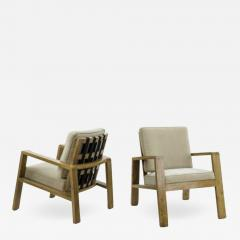 Jean Roy re Jean Royere pair of documented oak slender lounge chairs - 835883