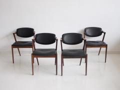 Kai Kristiansen Set of Four Model 42 Black Leather and Hardwood Chairs by Kai Kristiansen - 1263431