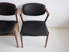 Kai Kristiansen Set of Four Model 42 Black Leather and Hardwood Chairs by Kai Kristiansen - 1263432