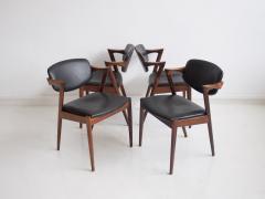Kai Kristiansen Set of Four Model 42 Black Leather and Hardwood Chairs by Kai Kristiansen - 1263435