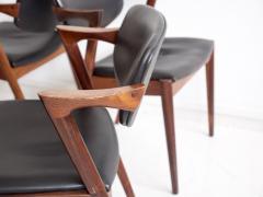Kai Kristiansen Set of Four Model 42 Black Leather and Hardwood Chairs by Kai Kristiansen - 1263442