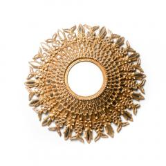 Line Vautrin A large round segmented and carved giltwood mirror in the manner of Line Vautrin - 2007432