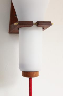 Louis Christiaan Kalff Single Scandinavian teak and white opaline sconce 1960s - 998130