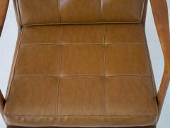 Lounge Chair with Wooden Frame and Brown Leather Cushions - 1506281