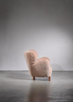 Lounge chair with lambskin upholstery 1940s - 1702413