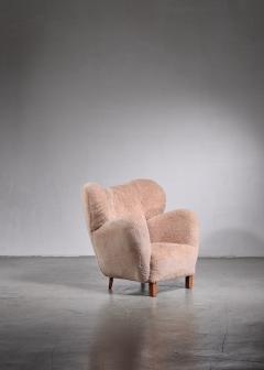 Lounge chair with lambskin upholstery 1940s - 1702414
