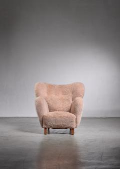 Lounge chair with lambskin upholstery 1940s - 1702415